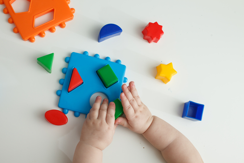 Kid playing with Montessori blocks